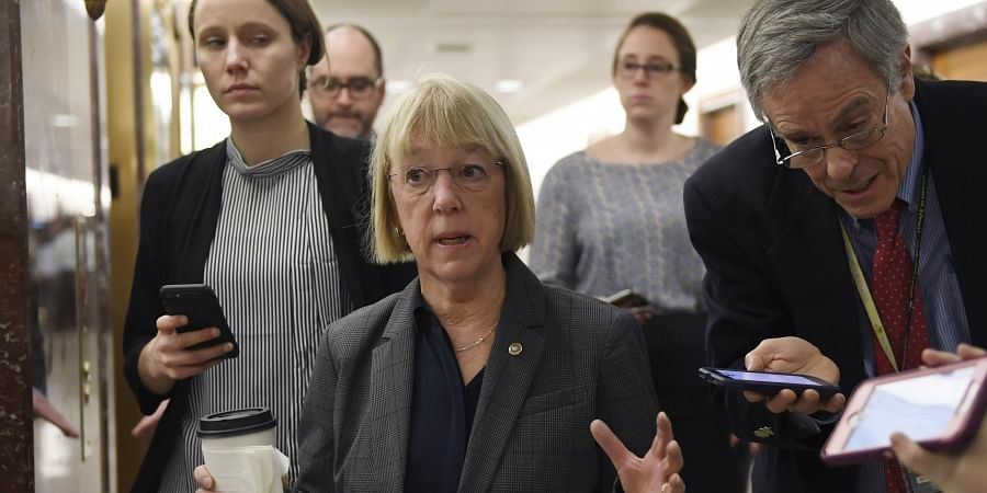Sen. Patty Murray, D-Wash., center, talks to reporters on Capitol Hill in Washington, Friday, Jan. 24, 2020, as she heads to a closed, all-senators briefing on the coronavirus.