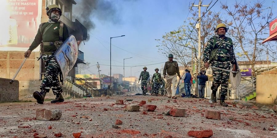 Jharkhand Police patrol a street after curfew was imposed following violence and arson that erupted at a rally in support of the Citizenship Amendment Act in Lohardaga district of Jharkhand Friday Jan. 24 2020.