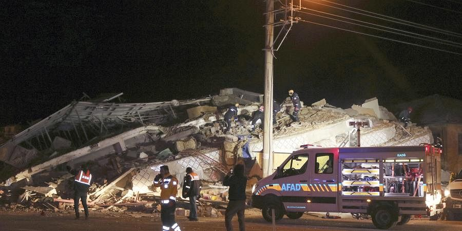 Rescue workers search on a collapsed building after a 6.8 earthquake struck Sivrice town in Elazig in eastern Turkey
