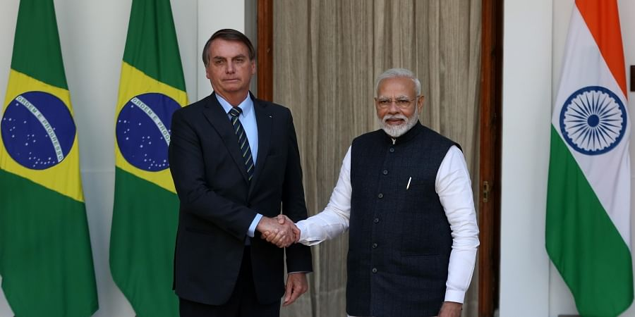 Prime Minister Narendra Modi shakes hand with Brazilian President Jair Messias Bolsonaro prior to a meeting at Hyderabad House in New Delhi on Saturday.
