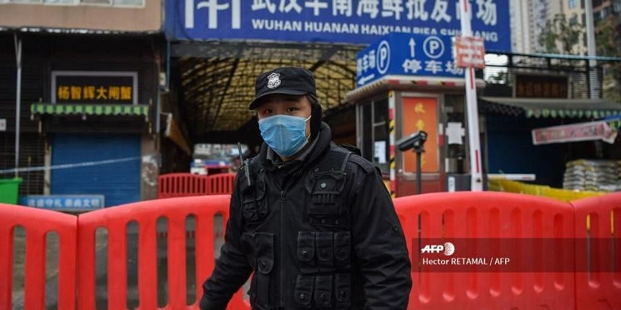 A police officer stands guard outside of Huanan Seafood Wholesale market where the coronavirus was detected in Wuhan on January 24, 2020. (PHOTO | AFP)