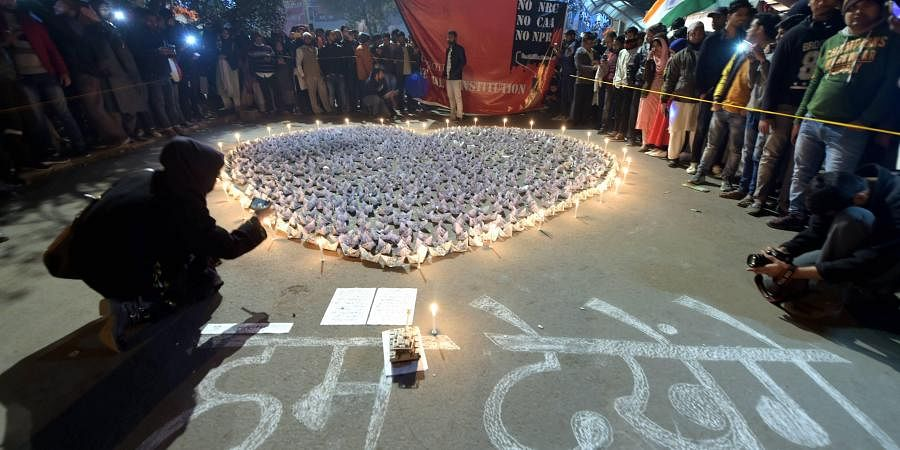 Protestors made an art in a demonstration against Citizenship Amendment Act and NRC at Shaheen Bagh in New Delhi. (Photo   PTI)