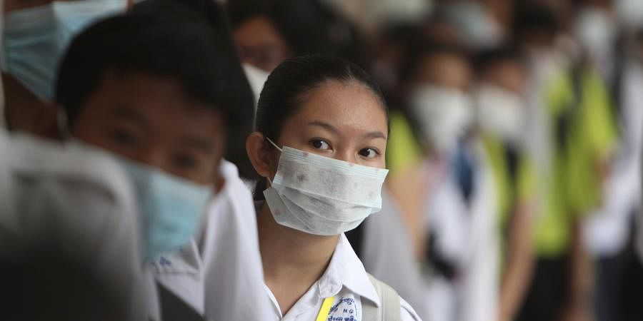Students line up to sanitize their hands to avoid the contact of coronavirus before their morning class at a hight school in Phnom Penh, Cambodia, Tuesday, Jan. 28, 2020.