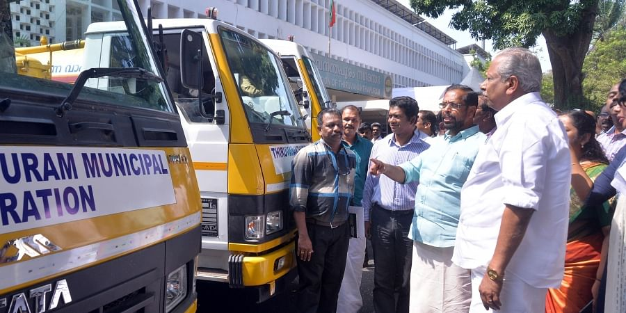 Minister A C Moideen and Mayor K Sreekumar inspecting the vehicles for collecting septage from the houses and hotels in Thiruvananthapuram as part of the initiative by the city corporation
