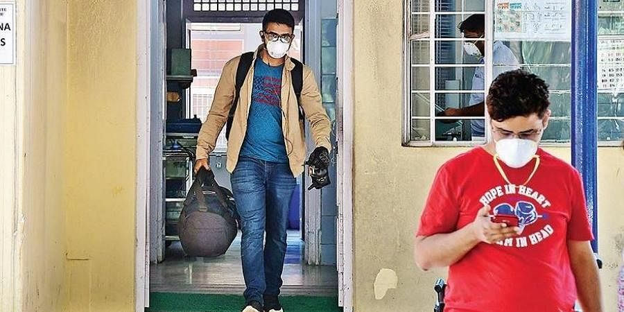 A youth who returned from China comes out of Rajiv Gandhi Institute of Chest Diseases after getting tested for coronavirus in Bengaluru on Wednesday