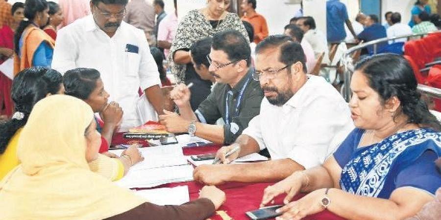 Mayor K Sreekumar and Deputy Mayor Rakhi Ravikumar hearing  the complainants at the adalat on Thursday