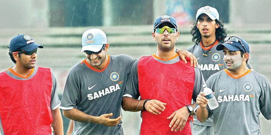 Indian cricketers Irfan Pathan (2L), Yuvraj Singh (C), Ishant Sharma (2R) and Gautam Gambhir (R) share a light moment during a training session at Shrer-e-Bangla National Cricket Stadium in Dhaka.