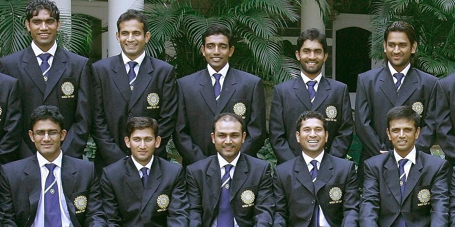 Indian cricketers (standing L-R) Munaf Patel, Irfan Pathan, Robin Uthappa, Dinesh Karthick, Mahendra Singh Dhoni and (seated L-R) Anil Kumble, Ajit Agarkar, Virender Sehwag, Sachin Tendulkar, and Rahul Dravid pose for a team photo prior to their departure for the ICC World Cup 2007 to West Indies, in Mumbai.