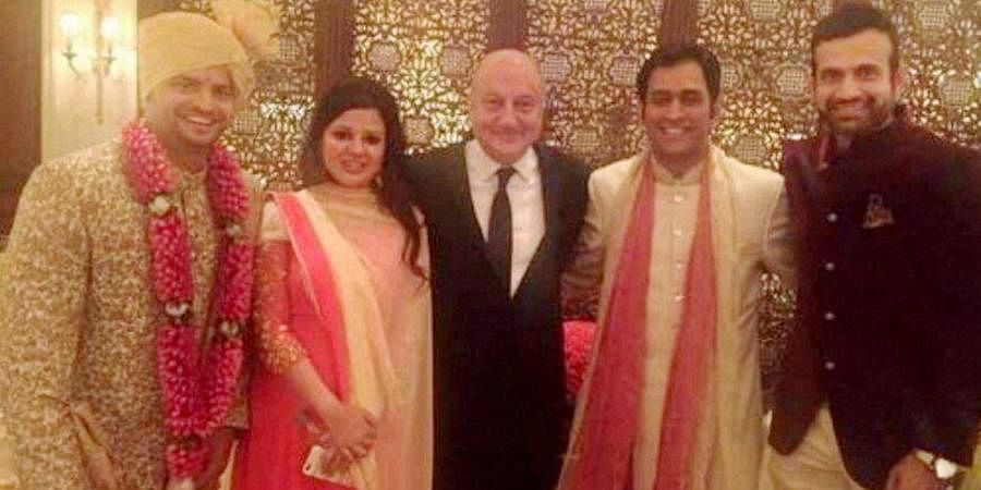 Indian cricketer Suresh Raina along with MS Dhoni, his wife Sakshi, Irfan Pathan and actor Anupham Kher during his wedding ceremony in New Delhi.