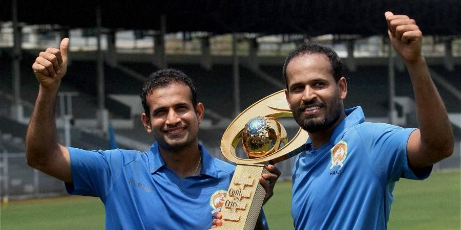 Baroda's Irfan Pathan and Yusuf Pathan pose with Syed Mushtaq Ali Trophy after their win over Punjab in the final match of the tournament in Mumbai.