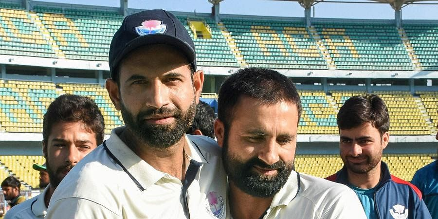 Jammu and Kashmir cricketers Parvez Rasool and Irfan Pathan greet each other after winning the Ranji Trophy match against Assam in Guwahati.