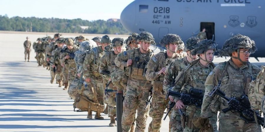US Army Paratroopers assigned to the 2nd Battalion, 504th Parachute Infantry Regiment, 1st Brigade Combat Team, 82nd Airborne Division, deploy from Pope Army Airfield, North Carolina