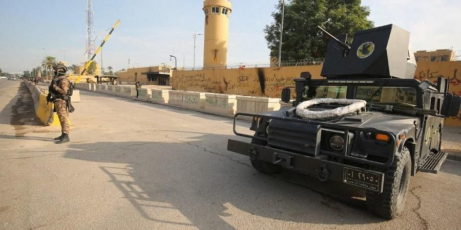 Iraqi counter-terrorism forces stand guard in front of the US embassy in the capital Baghdad