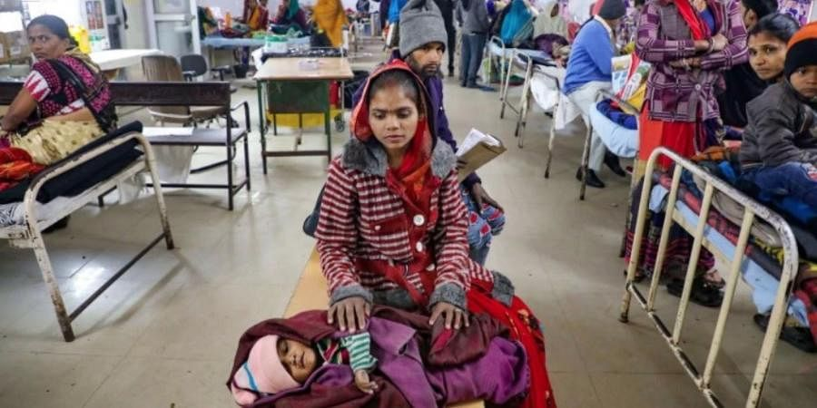 A mother waits for treatment of her child at JK Lon hospital in Kota, Rajasthan.