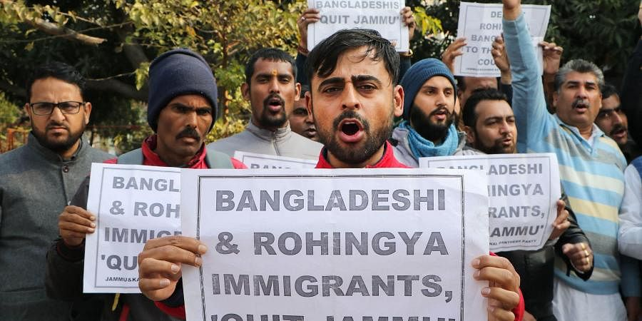 Activists of Jammu and Kashmir National Panthers Party (JKNPP) raise slogans during a protest against the alleged settlement of Rohingyas and Bangladeshis, in Jammu