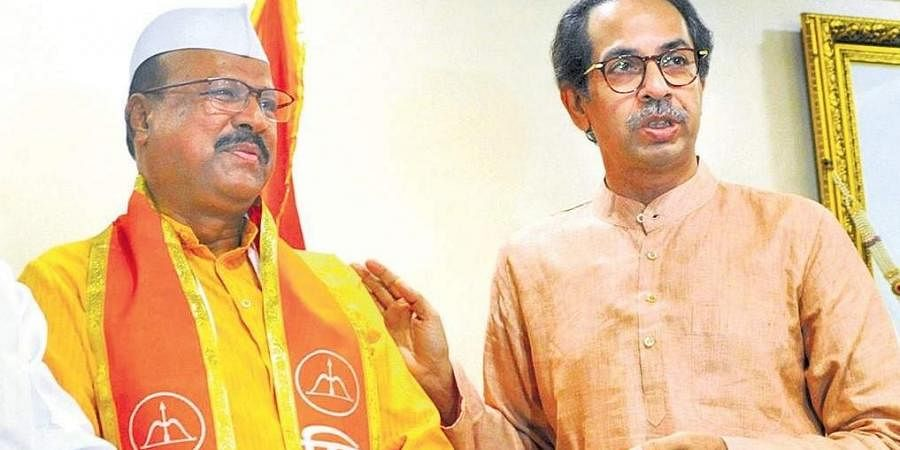 Abdul Sattar with Maharashtra CM Uddhav Thackeray during his induction into the Shiv Sena.