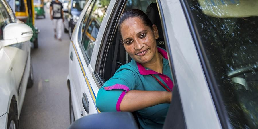 In this undated photo a woman chauffeur employed at Delhi-based Azad foundation's driving a car. Driven by financial need and sometimes to just look for fresh career opportunities the women are cutting through gender barriers to ensure they steer the course of their lives and also stay the course