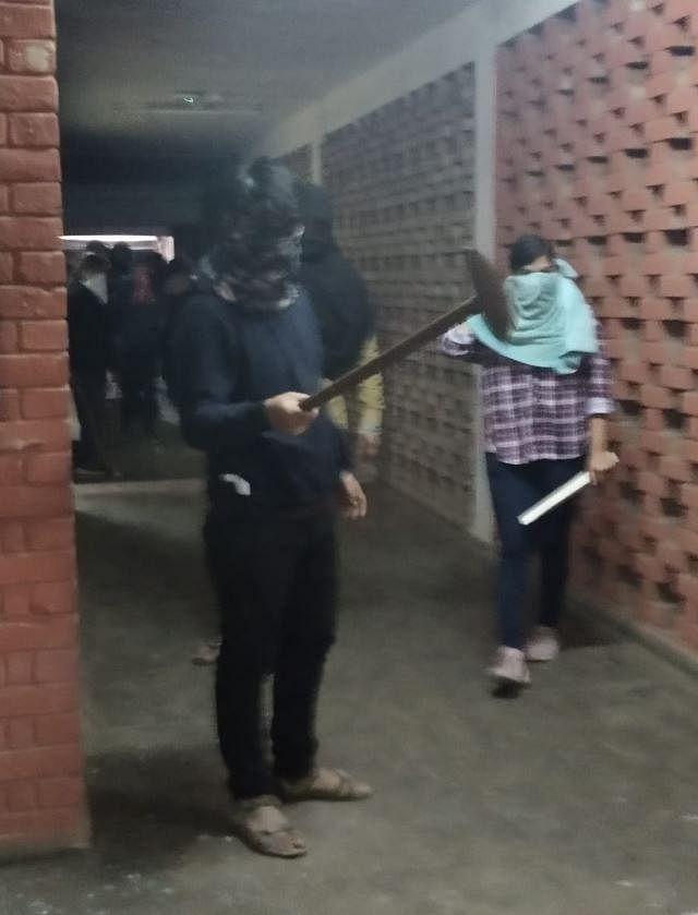 Masked micreants seen holding wooden and metal rods. Destruction wreaked in the JNU campus on Sunday evening.