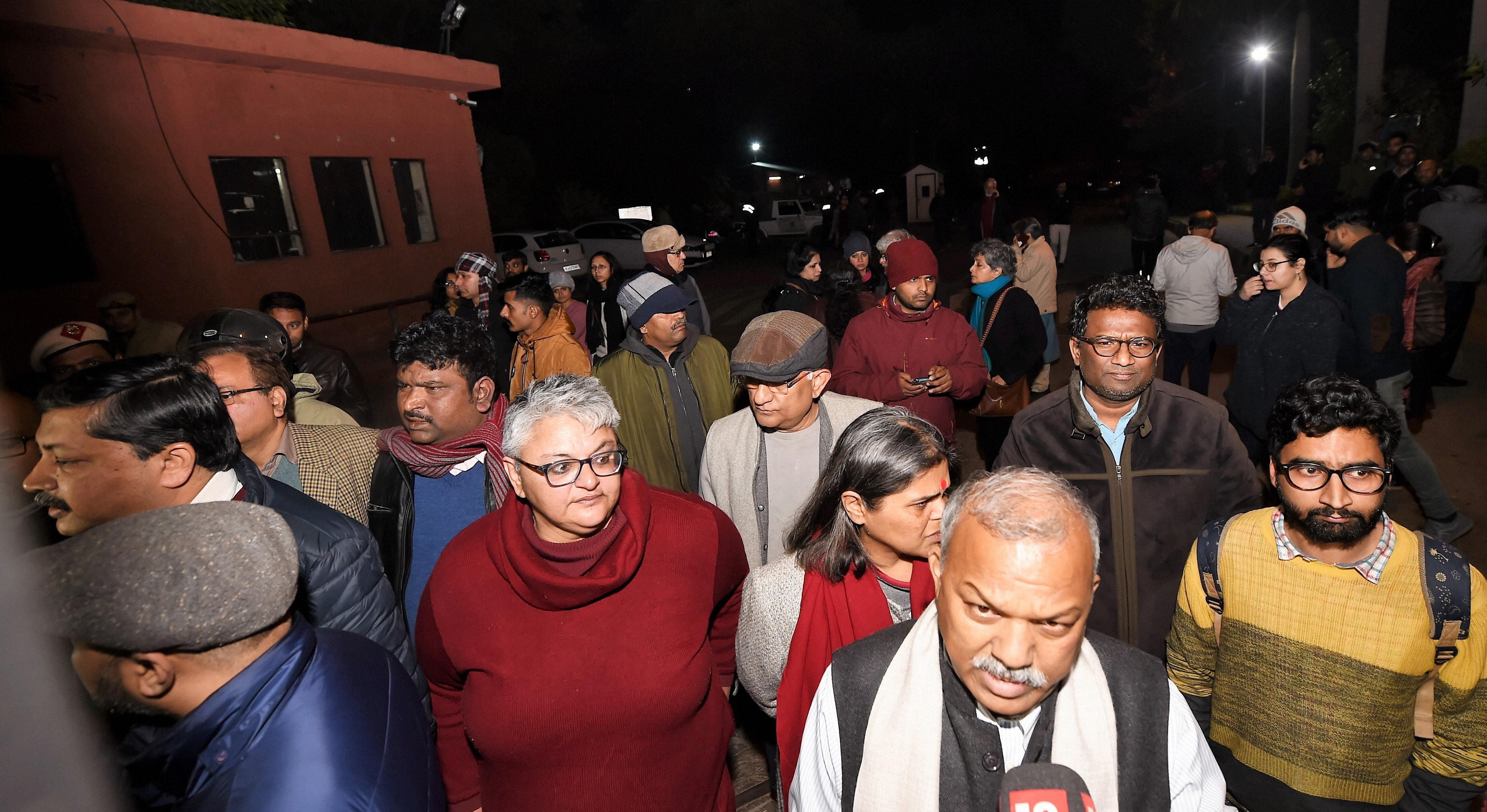 JNU professors walk in solidarity with students after miscreants wreaked havoc on campus.