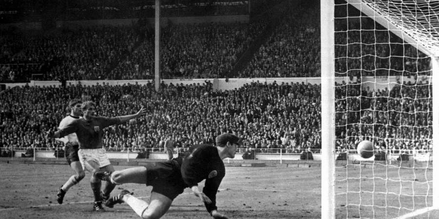 The July 30, 1966 file photo shows England's controversial third goal scored by Geoff Hurst (not in photo) past German goalkeeper Hans Tilkowski in the World Cup Final soccer match at London's Wembley Stadium. (Photo | AP)
