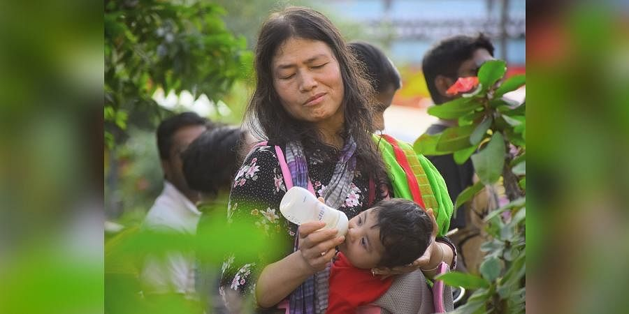 Activist Irom Sharmila feeds one of her twin daughters during a protest against the Citizenship Amendment Act, National Register of Citizens, and National Population Register, in Bengaluru on Sunday.