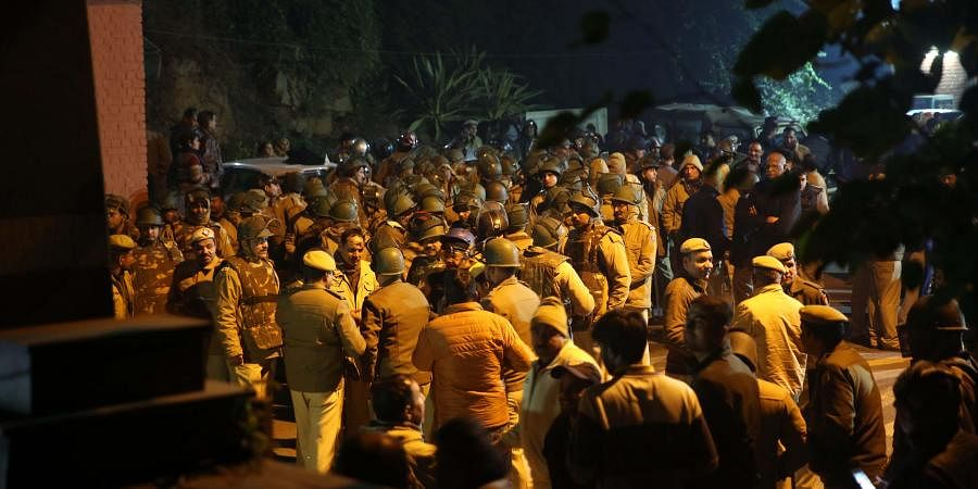 Police at out side of the JNU campus after some masked miscreants attacked in the campus New Delhi on Sunday.