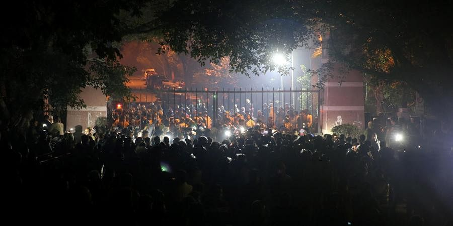 Police and others at out side of the JNU campus after some masked miscreants attacked in the campus New Delhi on Sunday.