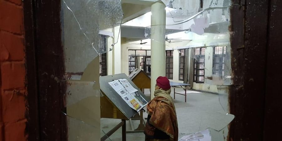 Vandalised hostel rooms and broken vehicles out side the sabarmati hostel in JNU on Monday.