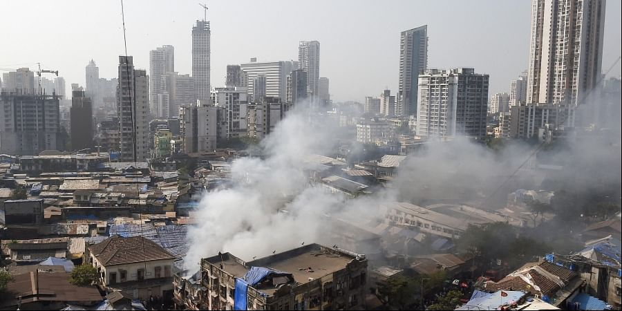 Smoke billows out of a building where a broke out at Kamathipura in Mumbai