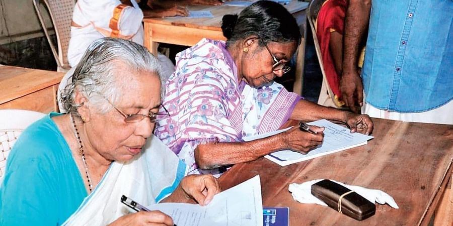 Sarasamma, 90, writes Class IV equivalency examination at the Thrikkannapuram government school on Sunday