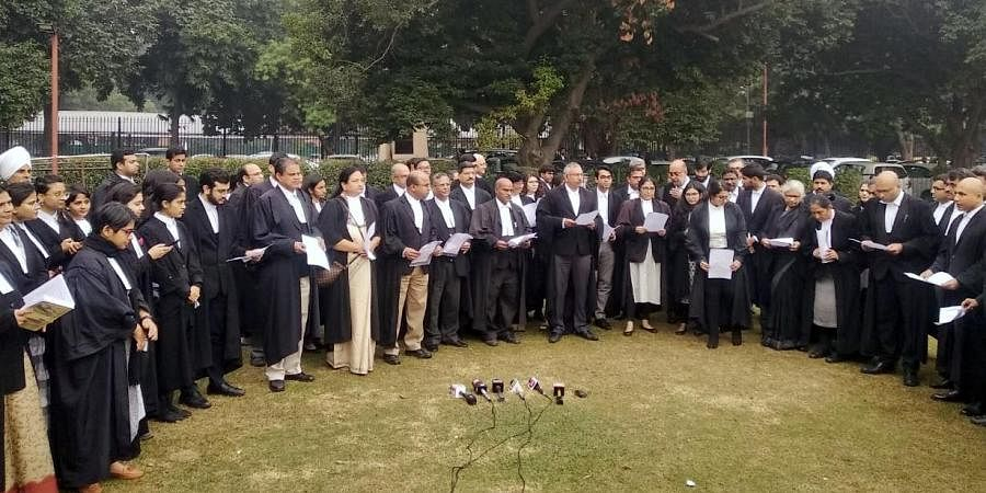 A group of lawyers read the preamble of the constitution at Supreme Court lawns.