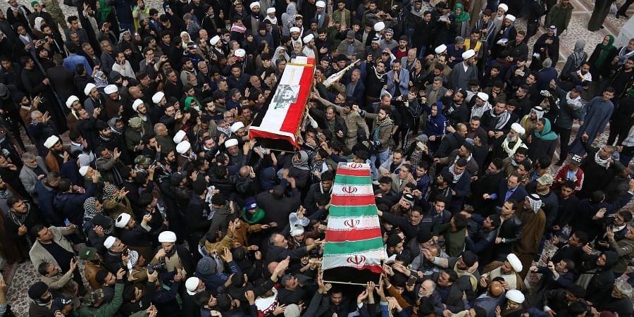 Mourners carry the coffins of Iran's Gen. Qassem Soleimani and Abu Mahdi al-Muhandis, deputy commander of Iran-backed militias at the Imam Ali shrine in Najaf, Iraq.