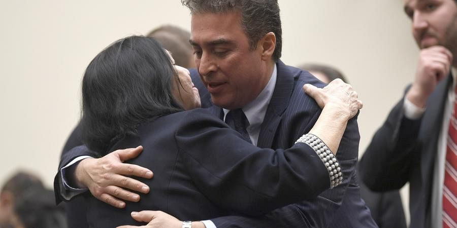 In this March 7, 2019, file photo, Christine Levinson, wife of Robert Levinson, a former FBI agent who vanished in Iran in 2007, left, gets a hug from Babak Namazi, right, the son of Baquer Namazi who has been held in Iran, following their testimony before a House Foreign Affairs Subcommittee on Capitol Hill in Washington. The killing of a top Iranian general has ratcheted up the anxiety of families of Americans held in Iran.