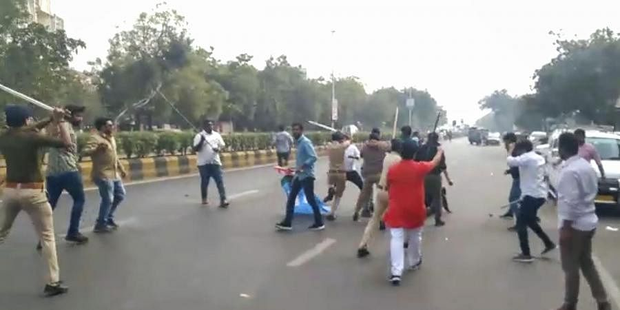 A screenshot taken from a video footage shows the police intervening as ABVP and NSUI students enagage in violent clash.