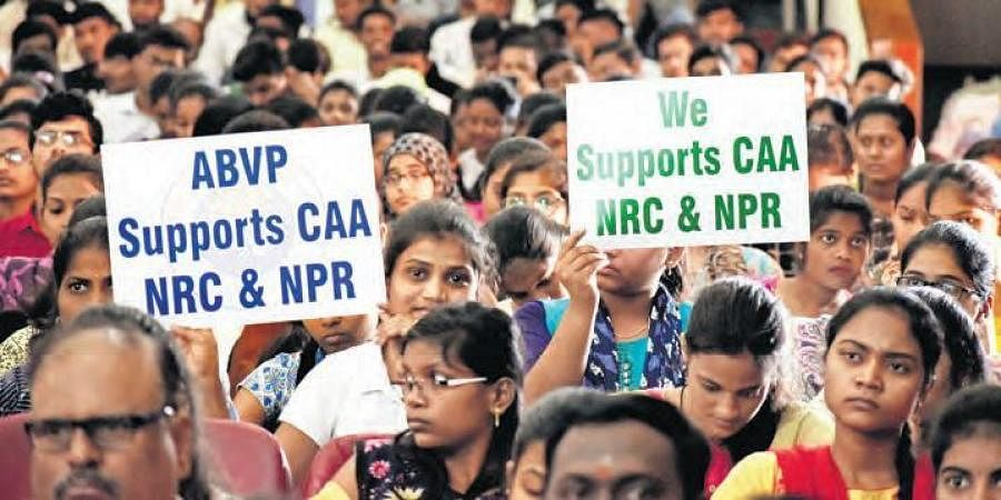 Students hold pro-CAA placards during BJP national general secretary Ram Madhav's meeting, in Osmania University on Friday.
