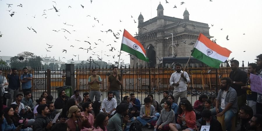 Students stage a protest near the Gateway of India to condemn the violence at Delhi's Jawaharlal Nehru University in Mumbai.