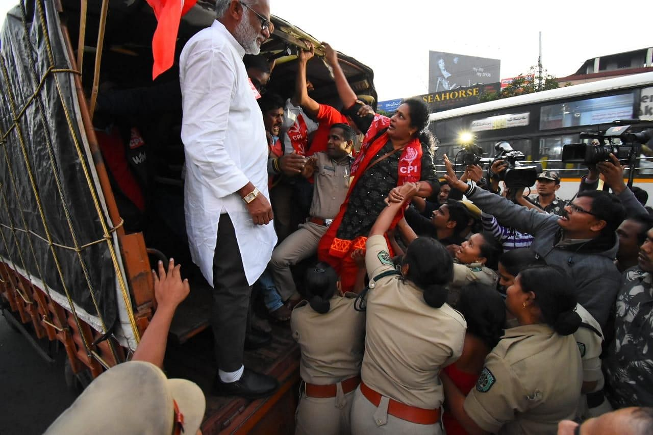 Left party leaders and workers being arrested during all India strike at Maddilapalem in Visakhapatnam.