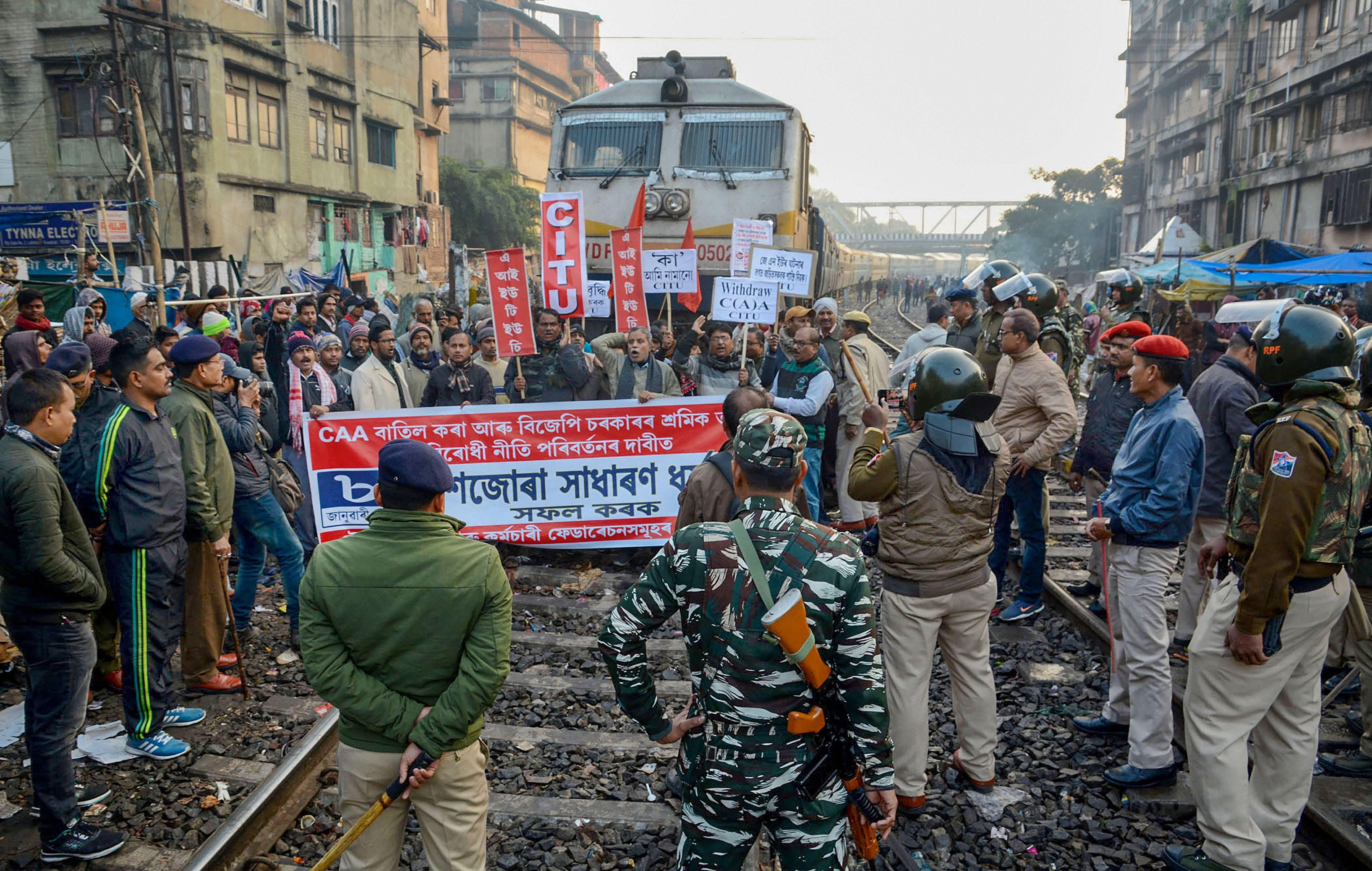 Members of CITU block the Trivandrum Express in Guwahati.