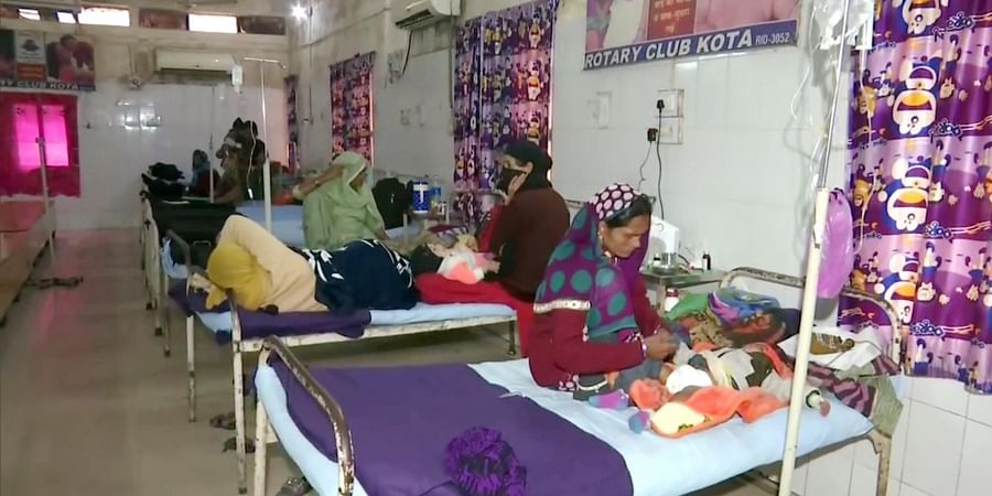 Family members with their children who are admitted to JK Lone Hospital, in Kota on Friday