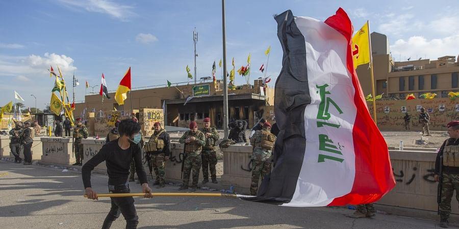 A man waves the Iraqi flag