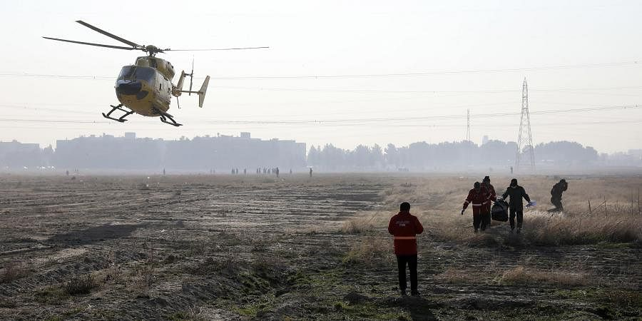 Rescue team work at the scene where an Ukrainian plane crashed in Shahedshahr, southwest of the capital Tehran, Iran. (Photo   AP)