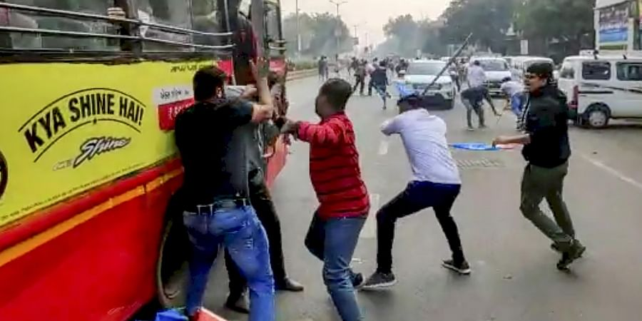 A screenshot taken from a video footage shows ABVP and NSUI students engaged in a violent clash in Ahmedabad Gujarat Tuesday Jan. 7 2020. (Photo | PTI)