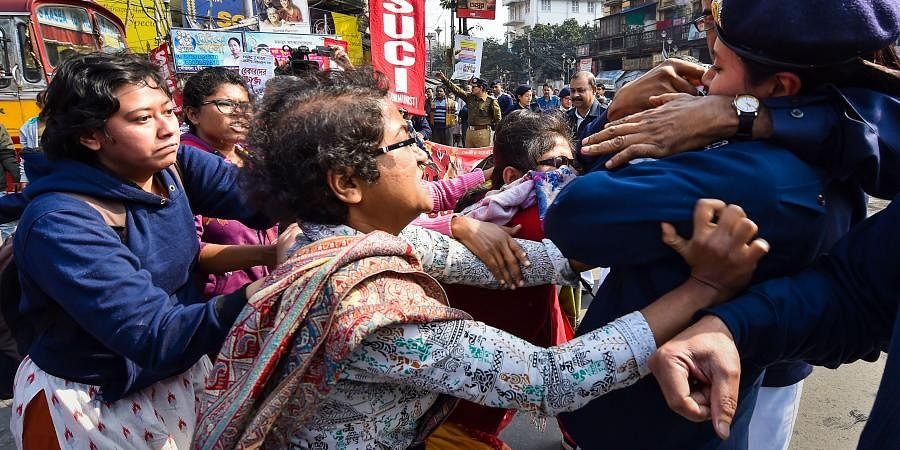 Police detain SUCI activists who were staging a road blockade in support of the trade unions' Bharat Bandh in Kolkata Wednesday Jan. 8 2020. (Photo | PTI)