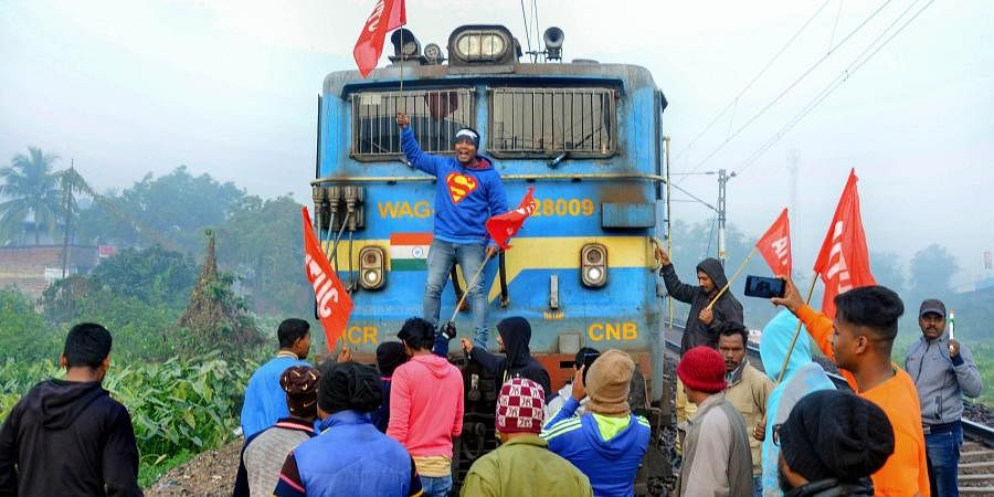 Members of AITUC and INTUC block a train during the trade unions' nationwide strike in West Midnapore district of West Bengal Wednesday Jan. 8 2020. (Photo   PTI)