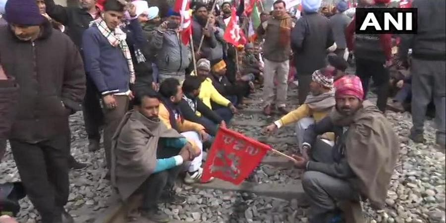 Protesters block a railway track in Amritsar during Bharat Bandh