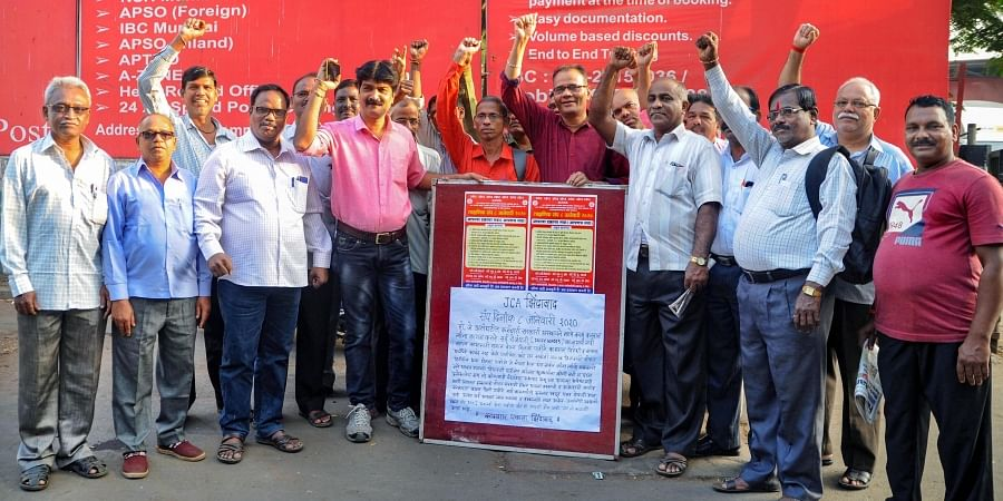 Members of a trade union stage a protest during the 24-hour nationwide strike called by ten trade unions against the central government over various issues in Mumbai