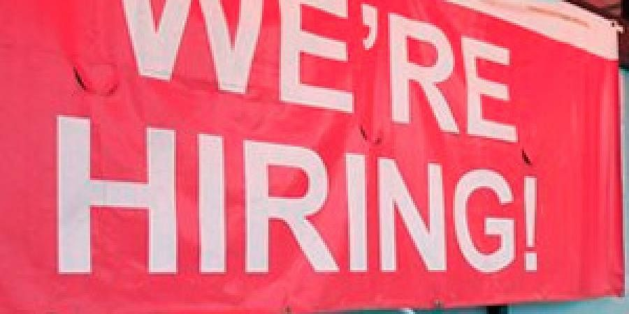 India's outsourcing giants, faced with rising wages at home, are hiring workers in North America, says a media report.
