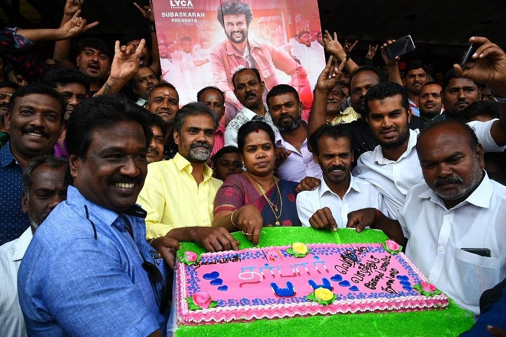 Rajinikanth fans celebrating the release of  'Darbar' movie by cutting a cake in front of theater in Coimbatore on Thursday.