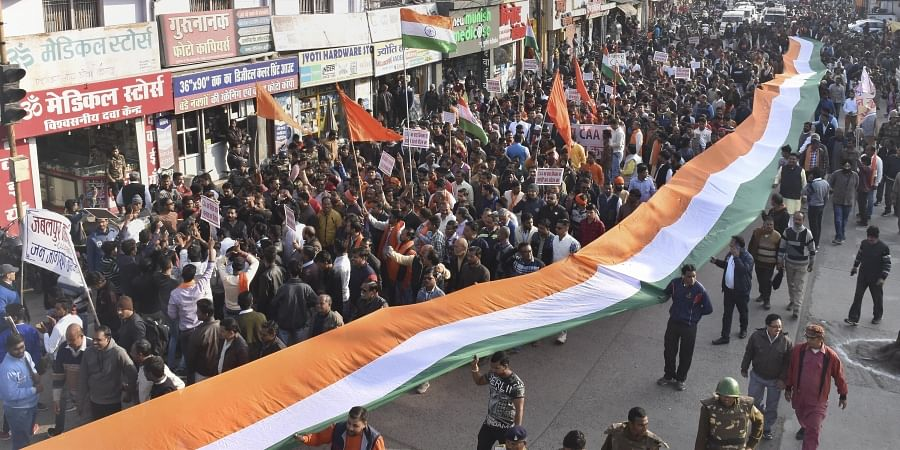 People carry a huge tri-colour as they take part in a 'Padyatra' in supporting of the Citizenship Amendment Act in Jabalpur Thursday Jan. 9 2020. (Photo | PTI)
