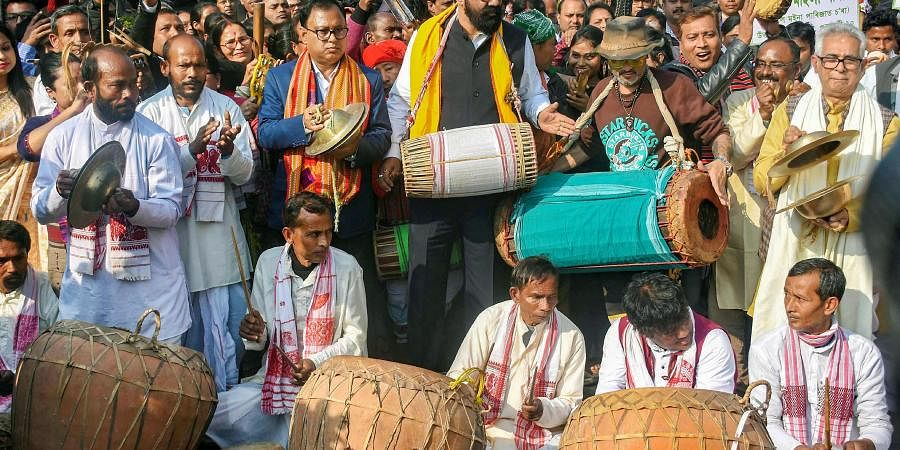 Singer Zubeen Garg with All Assam Students Union AASU chief advisor Samujjal Bhattcharjya and AASU President Dipankar Kumar Nath and other artists from different part of Assam play traditional instruments during the 'Ran Singa' protest against the Citizenship Amendment Act in Guwahati Thursday Jan. 9 2020. (Photo | PTI)